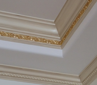 Crown moulding with glaze finish and gold leaf