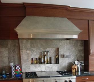 Stone finish on range hood to match backsplash