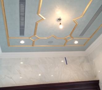 Venetian plaster ceiling with gold leaf on plaster trim